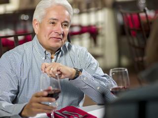 Hispanic man having dinner in restaurant