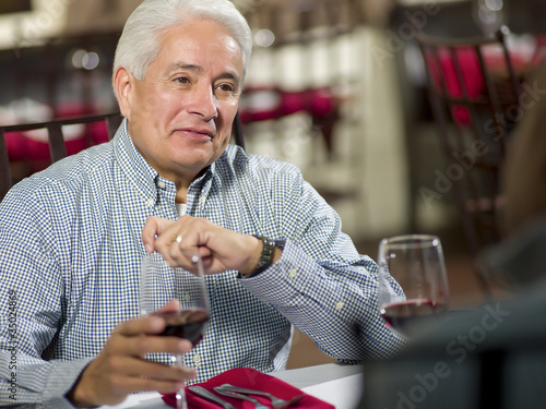 Hispanic man having dinner in restaurant