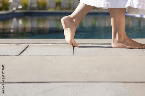 Woman walking near swimming pool