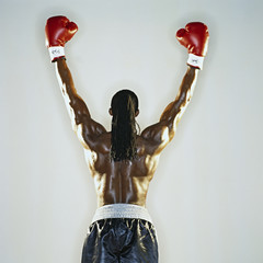 Boxer standing with hands raised