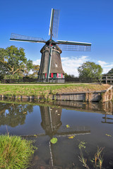 The village in Holland with windmills and  channel