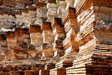 the repetition of brick pattern at the pagoda , thailand poster
