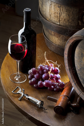 still life with red wine on table