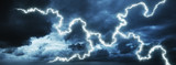 Dark stormy sky with a lightning. Panoramic image.