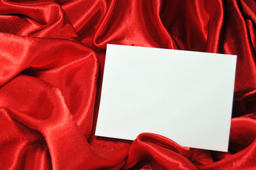 Blank card on red silk