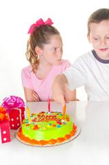 Boy bothering birthday girl
