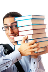 Student with stack of books on white