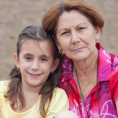 Portrait of a cute latin girl and her grandmother