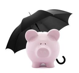 Financial insurance. Piggy bank with umbrella
