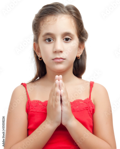 Latin girl praying isolated on a white background