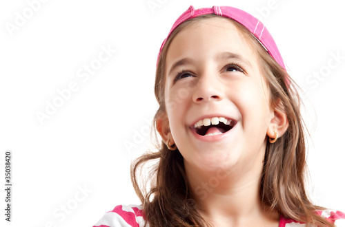 Trendy hispanic girl laughing isolated on  white