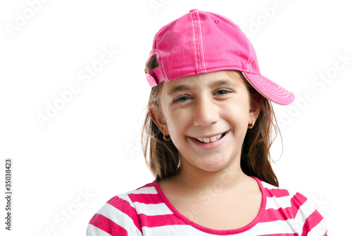 Portrait of a cute latin girl wearing a pink baseball cap