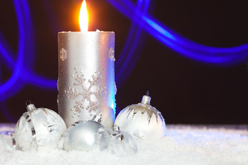 christmas background with candle, christmas balls and abstract l