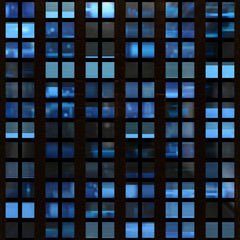 Seamless texture of modern building windows at night