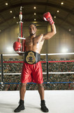 Winning African American boxer in boxing ring