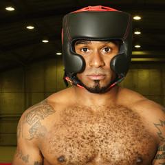 African American boxer in padded helmet