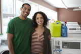 Mixed race couple in laundromat