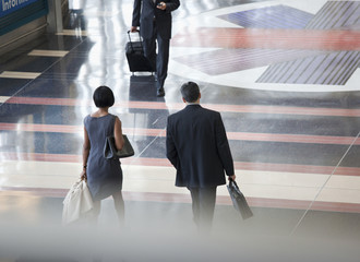 Business people walking in airport