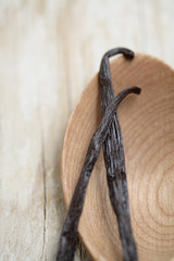 Close up of Mexican vanilla beans on wooden spoon