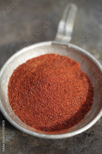 Close up of chili powder in measuring spoon