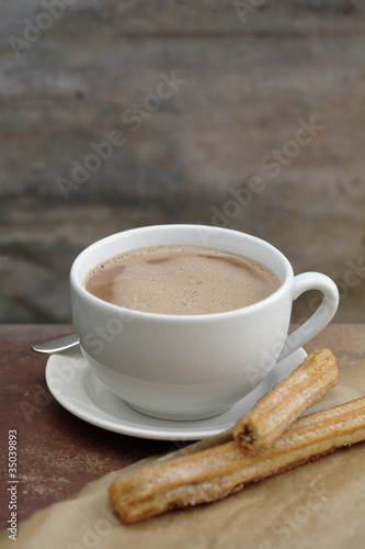 Close up of churros and Mexican hot chocolate