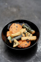 Close up of Japanese rice crackers in bowl