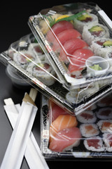 Sushi in takeout containers