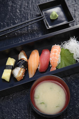 Nigiri sushi with wasabi and miso soup