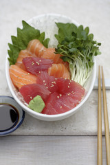 Close up of sashimi and sprouts