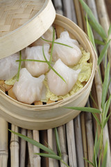 Close up of dim sum dumplings in bamboo basket