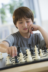 Mixed race boy playing chess