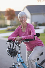 Mixed race woman on bicycle