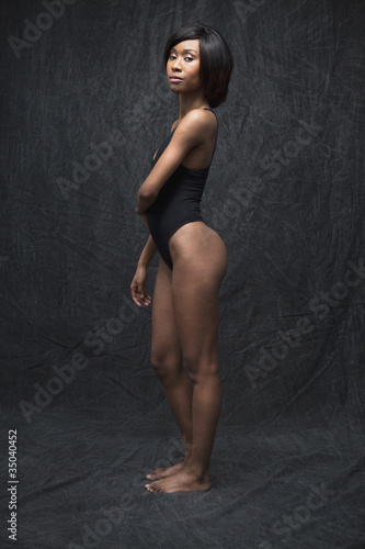 Black woman standing in leotard
