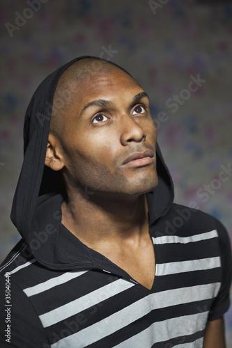 Serious Hispanic man wearing hoody