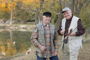 Caucasian men fishing together