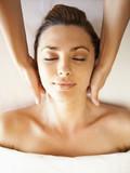Caucasian woman enjoying head massage