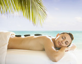 Caucasian woman having hot stone massage