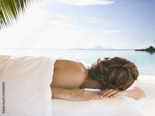 Caucasian woman waiting for massage