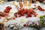 Close up of seafood displayed on ice