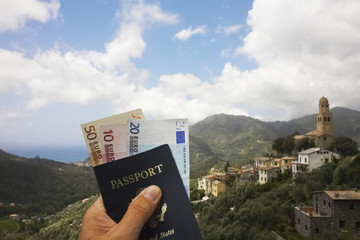 Man's hand holding passport and euro currency
