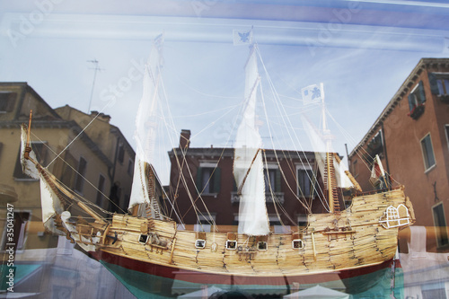 Wooden ship model behind glass