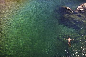 Caucasian man swimming in ocean
