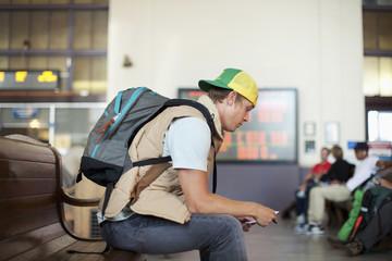 Caucasian man waiting in train station
