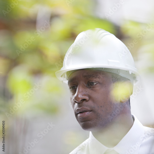 Serious Black man in hard-hat