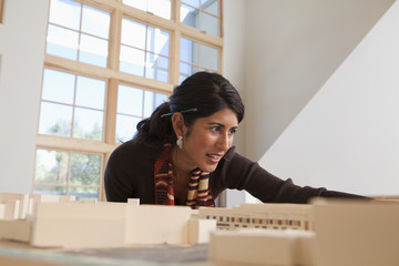 Architect reviewing building model in office