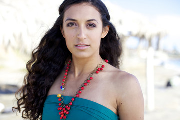 Serious mixed race woman wearing necklace
