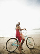 Couple riding retro bicycle on beach