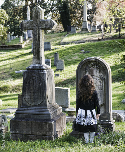 Hispanic girl visiting cemetery