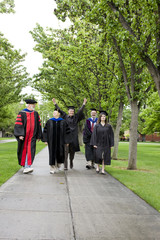 Professors and students walking to graduation