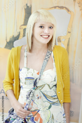 Smiling Caucasian girl in fashionable clothing